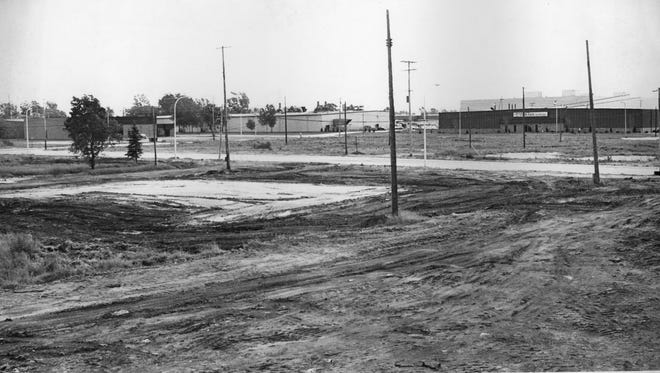 The Port Huron Industrial Park begins to rise from a muddy field on the city's western edge in this image from the 1960s. The original 200-acre site, put together from several parcels including the old city dump, now is nearly full. Times Herald photo.  BWM