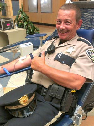 Deputy Rusty Callaway was one of several Doña Ana County Sheriff's deputies who stopped by the Mesilla Valley Mall last year for the Battle of the Badges blood drive, organized by United Blood Services. This year's drive will kick off Friday, Aug. 12 at the mall.