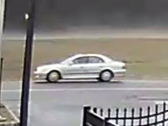 This is a picture of the gray or silver four-door sedan