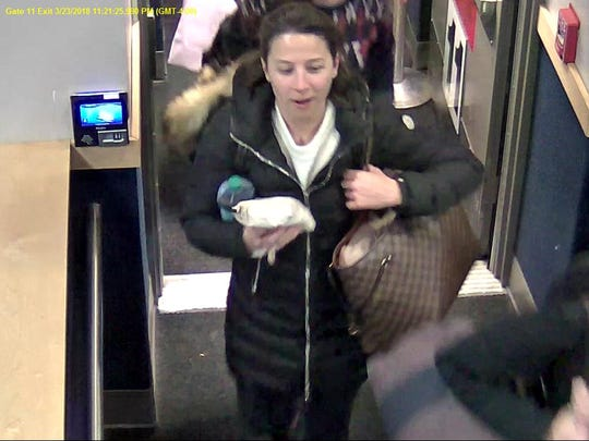 Burlington police released this photo as part of an effort to identify two women who they say stole a human-sized cardboard cutout of the owner of Leunig's Bistro from the Burlington International Airport in late March.