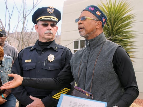 Alamogordo Police Department Acting Chief Roger Schoolcraft and Rev. Warren Robinson of the Owen Chapel A.M.E. Church stand in front of City Hall Monday after the march to honor Martin Luther King Jr. Monday.