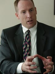 Walt Beglau talks about his first week as Marion County District Attorney during an interview on Friday Oct. 29, 2004.
