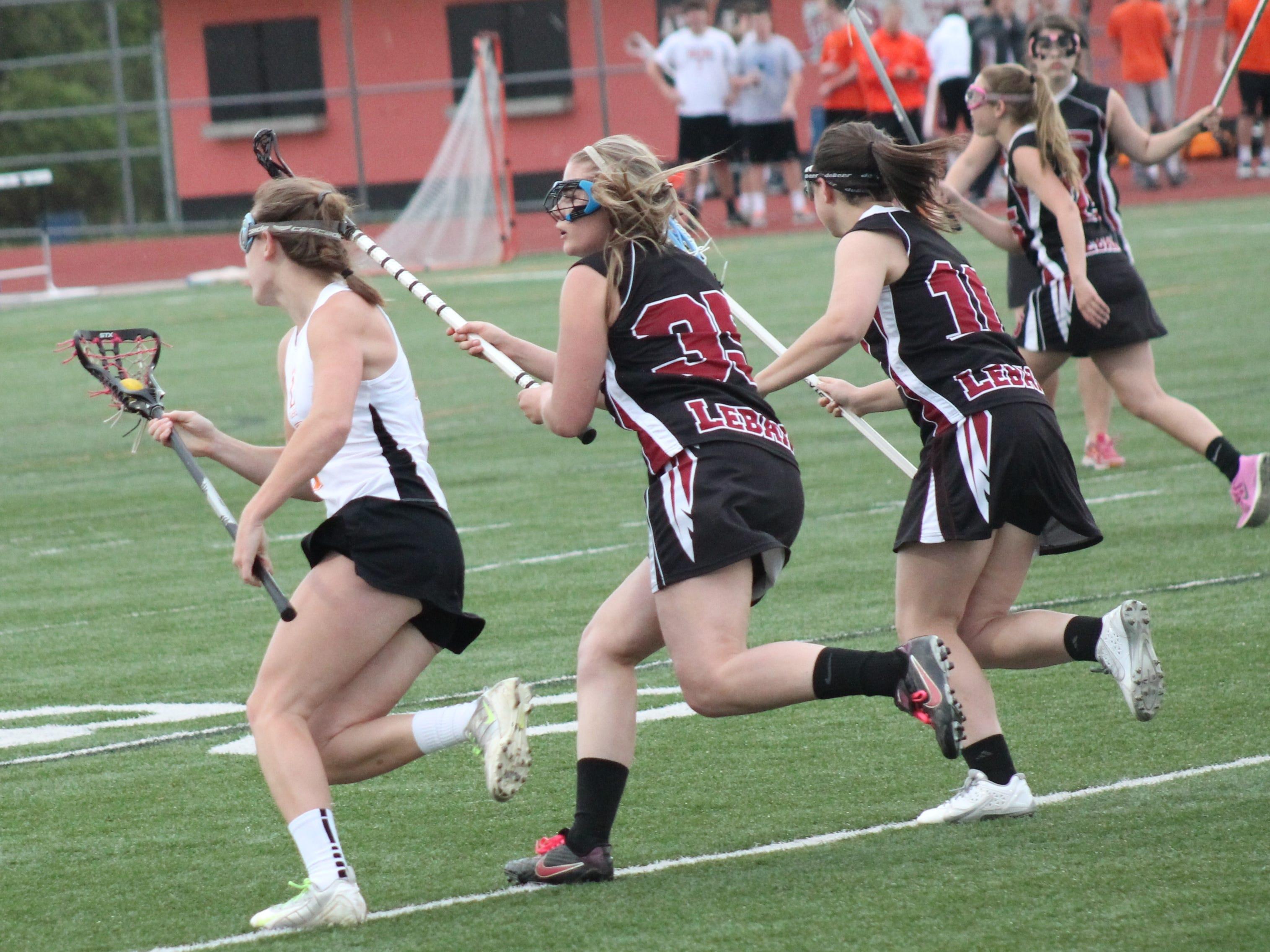Loveland's Katie McElveen outruns the Lebanon team toward the goal in a game last season.