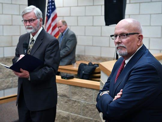 30th District Court Judge Bob Brotherton, right, listens