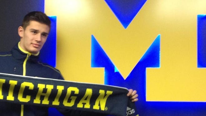 Matt Miazga held up a Michigan scarf after signing with the school. Miazga went pro instead.