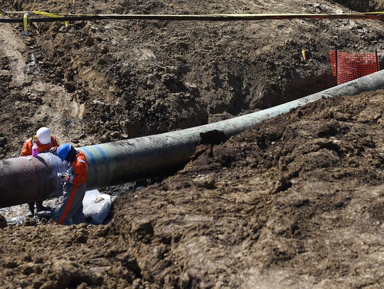 A TransCanada crew works at the site of the oil pipeline
