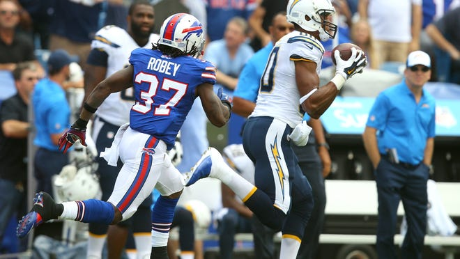 Chargers receiver Malcolm Floyd makes a 49-yard catch behind Buffalo's Nickell Robey earlier this season. Several Bills defenders are adjusting to the way games are being called this season.