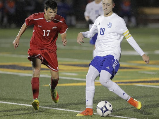 Oshkosh West's Noah Steinhilber is challenged by Kimberly's