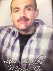 A photo of a memorial flyer for Luis Morin Jr., provided