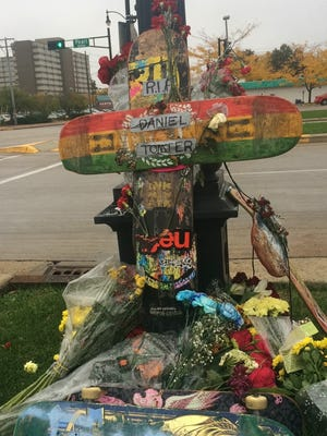 A curbside memorial for Daniel Tompter, 20, of Oshkosh sits Wednesday, Oct. 12, 2016, at the intersection of Wisconsin Street and Pearl Avenue.
