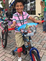 Jack Juarez tests out one of the 45 bikes that were donated by the St. Lucie County Sheriff's Office to the Toy Drive Block Party.
