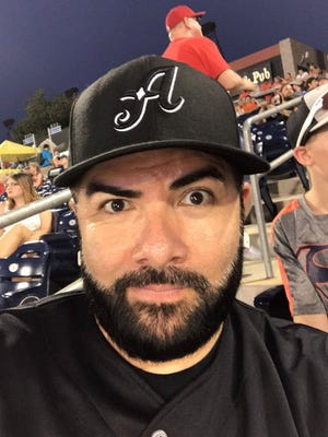 Former KRZQ operations manager Chris Payne takes a selfie at an Aces baseball game.