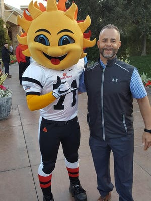 Former York High football coach Eric Lauer got an up-close look at Penn State's football operation before the Fiesta Bowl. And he came away impressed over the other teams he's seen over the years. Here, he poses with the bowl mascot, Spirit.