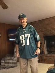 Ed Celek, 93, wears his grandson Brent's No. 87 jersey as he watches Super Bowl LII Sunday in Fremont.