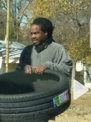 Suspect seen on surveillance removing tires at Wally's