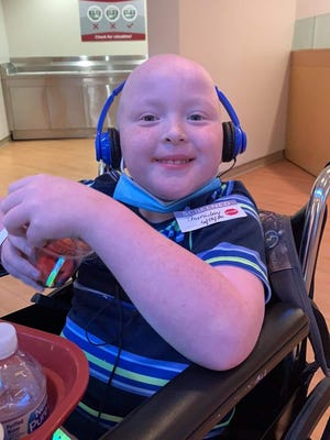 Landen Skillman, 10, eating strawberries at St. Jude's Hospital in Memphis. The Southside boy is about one month into treatments at the children's hospital.