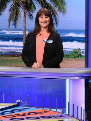 """Marci Hyland stands at the eponymous wheel on the set of """"Wheel of Fortune"""""""