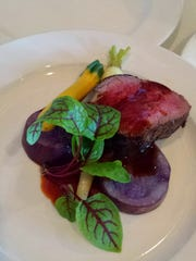 Red-wine poached beef tenderloin from Rumrunners chef-partner Todd Johnson.