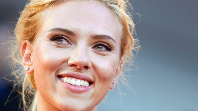 """Scarlett Johansson, shown in September, has  """"a fundamental difference of opinion"""" with Oxfam International because the humanitarian group opposes all trade from Israeli settlements, saying they are illegal and deny Palestinian rights."""