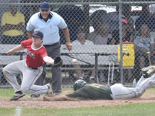 Washington Island's Caleb Cornell steals home on an error by Egg Harbor during Door County League baseball on Sunday at Egg Harbor. Attempting to field the ball is Riley Spetz of Egg Harbor.