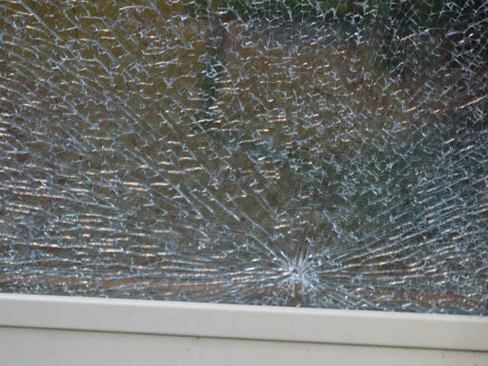 It appeared an object was thrown at the patio doors, which caused them to completely shatter.