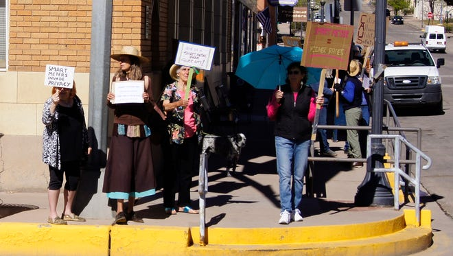 Protesters gather in front of the city hall in Silver City on Monday to protest PNM's proposed rate hike and the use of smart meters.