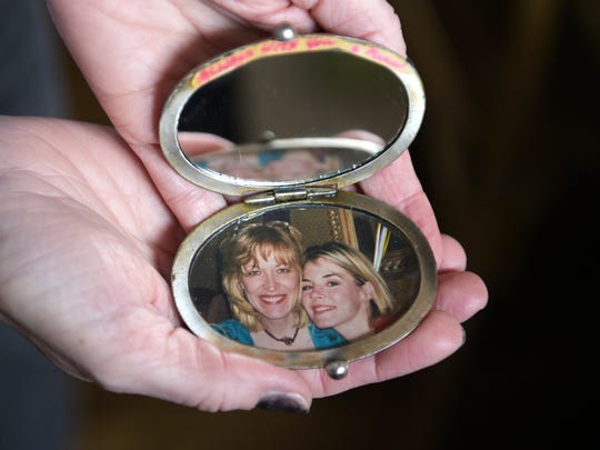 Jennifer Paige holds a locket that her mother gave