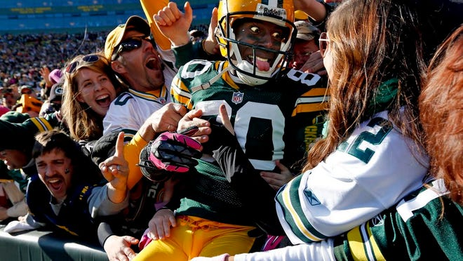 In this Oct. 28, 2012, file photo, Green Bay Packers wide receiver Donald Driver celebrates a touchdown after doing a Lambeau Leap during the second half of an NFL football game against the Jacksonville Jaguars, in Green Bay, Wisc.