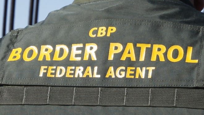 Border Patrol agents seized more than a pound of heroin from a man's shoes Tuesday.