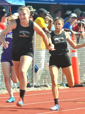 Eastern Christian senior Abigail Rodriguez (right) handing off to sophomore Madison Wynbeek during a relay race at the state Meet of Champions.