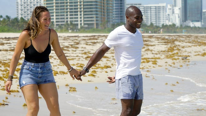 Simona Yan laughs as her fianceŽ, Domenic Yan, pulls her toward the surf on South Beach in Miami on Sept. 8, 2017. The couple came to see the beach one last time before Hurricane Irma hits.