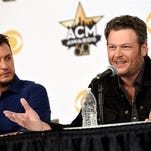 Blake Shelton, right, and Luke Bryan, co-hosts of Sunday's 50th Academy of Country Music Awards, laugh during a news conference on the event at AT&T Stadium on Friday in Arlington, Texas.