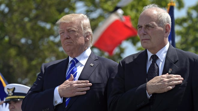 In this May 17, 2017, file photo, President Donald Trump and Homeland Security Secretary John Kelly listen to the national anthem during commencement exercises at the U.S. Coast Guard Academy in New London, Conn. Six months into presidency, Trump is saddled with a stalled agenda, a West Wing that resembles a viper's nest, a cloud of investigations and a Republican Party that is starting to break away. Against that daunting backdrop, Trump moved July 28 to overhaul his senior team, installing Kelly as White House chief of staff. The hard-nosed, retired general replaces Reince Priebus, a Republican operative who was skeptical of Trump's electoral prospects last year.(AP Photo/Susan Walsh, File)