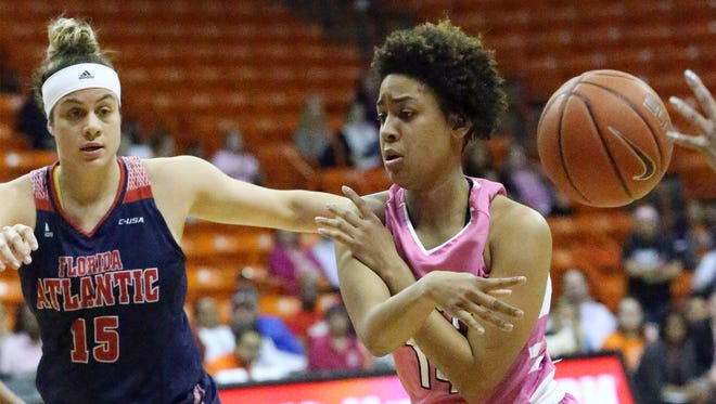 UTEP's Najala Howell flips the ball to a teammate while driving against Sasha Cedeño, 15, of Florida Atlantic Thursday night.