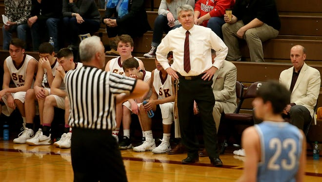 South Kitsap boys basketball coach John Callaghan looks on from the bench during a game against Curtis earlier this month. Callaghan faces a suspension after being ejected and refusing to leave the floor during Tuesday's road game against Olympia.