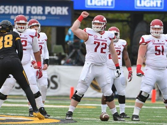 Arkansas offensive lineman Frank Ragnow (72) played both center and right guard in college.