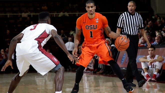Oregon State guard Gary Payton II (1) is defended by Stanford guard Malcolm Allen (3) during the first half of an NCAA college basketball game Thursday, Feb. 11, 2016, in Stanford, Calif.