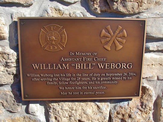 This plaque honoring fallen firefighter Bill Weborg was unveiled as part of the ceremony.