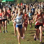 Running during a 2015 race is Salem's Madalyn Simko, one of the team's key returning runners.