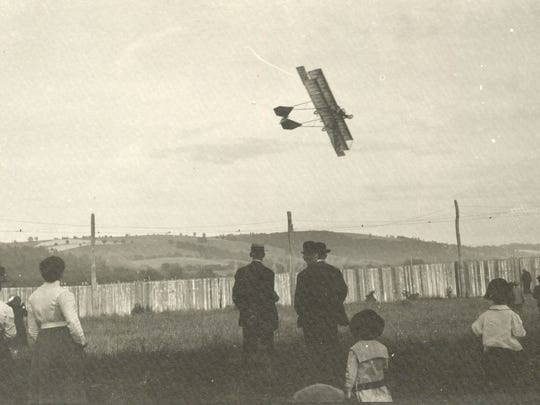 Lincoln Beachey's plane skims the sky above the crowd in 1912 in Elmira.
