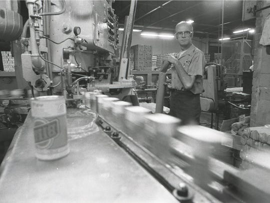 Cold Spring brewery employee Marc Nordman watches cans of Billy Beer be filled in the fall of 1977.