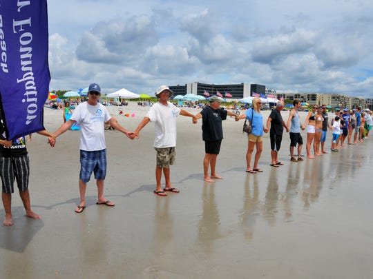 About 75 people showed up for Hands Across the Sand in Cocoa Beach in May 2016 to show their support for the environment and stand against offshore drilling and offshore seismic testing.
