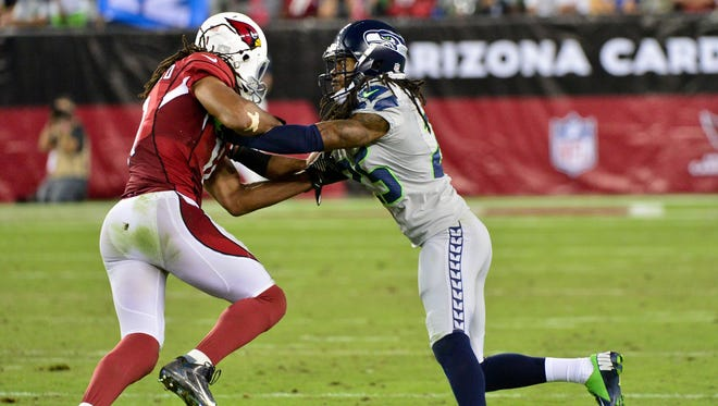 Arizona Cardinals wide receiver Larry Fitzgerald (11) and Seattle Seahawks cornerback Richard Sherman (25) are set to face off again a couple of times again this season.