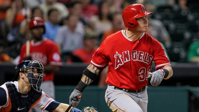 Los Angeles Angels left fielder Josh Hamilton (32) hits a home run during the eighth inning against the Houston Astros at Minute Maid Park.
