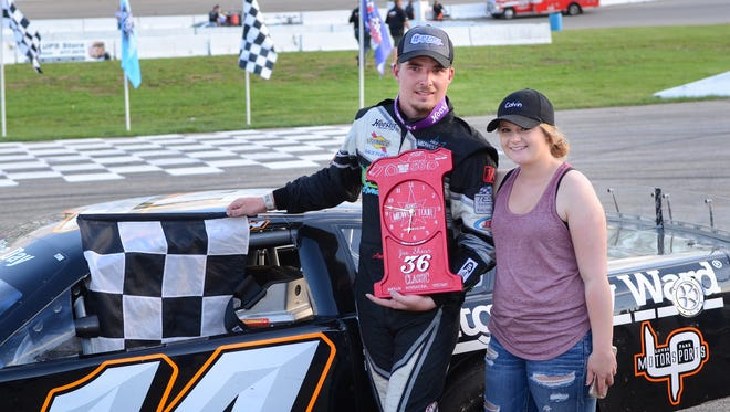 Austin Nason and his girlfriend, Taylor Colvin, pose in victory lane after he won the ARCA Midwest Tour Joe Shear Classic on Sunday at Madison International Speedway in the Town of Rutland.