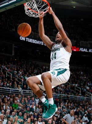 Michigan State's Nick Ward dunks against Stony Brook during the first half of an NCAA college basketball game, Sunday, Nov. 19, 2017, in East Lansing, Mich. Ward led Michigan State with 22 points in a 93-71 win.