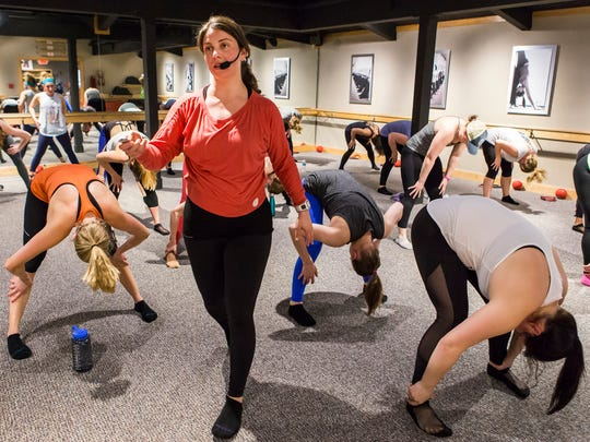 Maura Markley, owner of Pure Barre Greenville, leads a class on Wednesday, March 30, 2016.