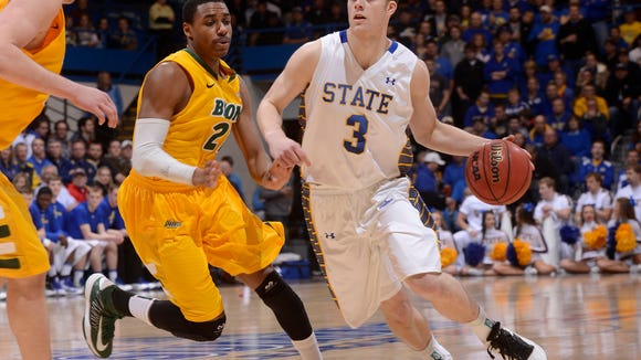 SDSU's Nate Wolters drives past NDSU's Kory Brown in Tuesday's Summit League men's basketball championship at the Sioux Falls Arena, March 12, 2013.