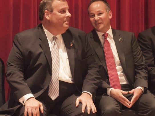 Gov. Chris Christie talks with Scott A. Coffina during