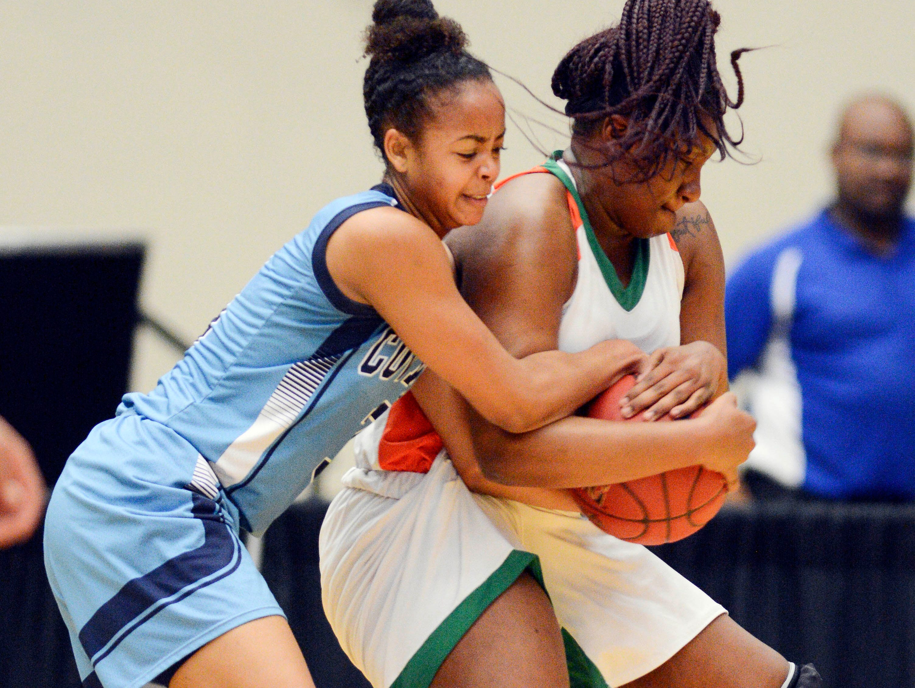 Alexis Gordon of Covenant Christian fights for the ball with Ambriel Scott of FAMU during the second quarter of their game at The Lakeland Center